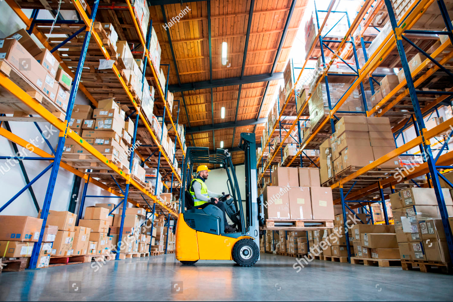 stock-photo-warehouse-man-worker-with-forklift-794138326